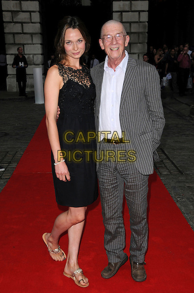 "ANNA WALTON & JOHN HURT.The ""Hellboy II: The Golden Army "" FilmFour Summer Screen Opening Gala, Somerset House, London, England..July 31st 2008.2 hell boy screening premiere full length black dress lace gold sandals flats grey gray suit shirt pinstripe .CAP/CAS.©Bob Cass/Capital Pictures."