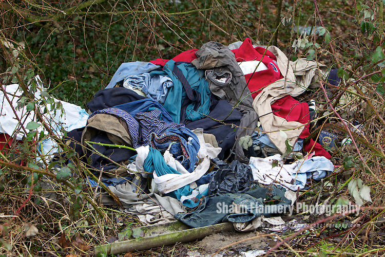 Pix: Shaun Flannery/shaunflanneryphotography.com...COPYRIGHT PICTURE>>SHAUN FLANNERY>01302-570814>>07778315553>>..9th February 2011.........A pile of clothes 'dumped' at a countryside beauty spot.