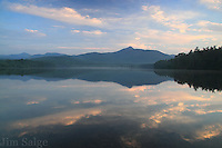 Warm colors from high clouds reflect off Chocorua Lake on a still morning.