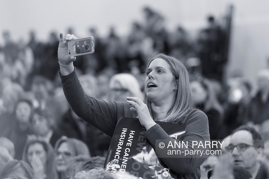 """Westbury, New York, USA. January 15, 2017.  Administrator of Together We Will Long Island, TWWLI, is recording a speaker at the """"Our First Stand"""" Rally against Republicans repealing the Affordable Care Act, ACA, taking millions of people off health insurance, making massive cuts to Medicaid, and defunding Palnned Parenthood. Hosts were Reps. Kathleen Rice (Democrat - 4th Congressional District) and Thomas Suozzi (Dem. - 3rd Congress. Dist.). It was one of dozens of nationwide Bernie Sanders' rallies for health care that Sunday."""
