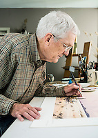 American painter Eldridge Hardie (cq) in his home studio in Denver, Colorado, Thursday, September 25, 2014. Hardie, born in 1940 near Boerne, Texas has lived in Colorado since 1966. An avid hunter and fisherman, Hardie is celebrated for his realistic paintings of wildlife and sportsman activities.<br /> <br /> Photo by Matt Nager