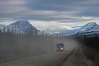 Dust gathers as industrial truckers travel the James Dalton Highway through the Brooks Range.