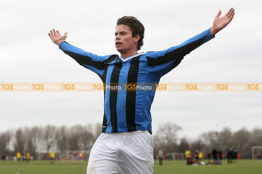 Inter Moore score their third goal and celebrate - Inter Moore (blue/black stripes) vs Arbour Athletic (light blue/white stripes) - East London Sunday League at South Marsh, Hackney Marshes - 06/02/11 - MANDATORY CREDIT: Gavin Ellis/TGSPHOTO - Self billing applies where appropriate - Tel: 0845 094 6026