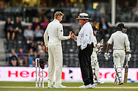 Marais Erasmus takes the ball from Joe Root of England after bad light stops play <br /> during Day 4 of the Second International Cricket Test match, New Zealand V England, Hagley Oval, Christchurch, New Zealand, 2nd April 2018.Copyright photo: John Davidson / www.photosport.nz