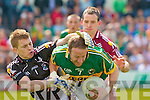 Kerry's Tommy Griffin and Galway's l-r: Adrian Faherty and Damien Burke.
