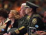 Carson City Undersheriff Steve Albertsen, left, and Sheriff Kenny Furlong listen to a memorial service for Carson City Sheriff's Deputy Carl Howell at the Reno Events Center in Reno, Nev., on Thursday, Aug. 20, 2015. Howell was shot and killed early Saturday morning after responding to a domestic violence call. (Cathleen Allison/Las Vegas Review-Journal)