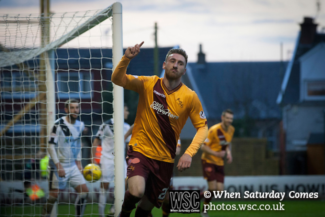 Motherwell 3 Dundee 1, 12/12/2015. Fir Park, Scottish Premiership. Home forward Louis Moult turns away in celebration after scoring with a header to put his team two-nil ahead in the first-half as Motherwell (in amber) play Dundee in a Scottish Premiership fixture at Fir Park. Formed in 1886, the  home side has played at Fir Park since 1895. Motherwell won the match by three goals to one, watched by a crowd of 3512 spectators. Photo by Colin McPherson.