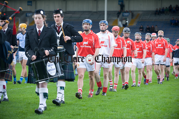 Gerry O Grady leads pout the Crusheen team in the parade before  the Munster Club final at Thurles. Photograph by John Kelly.