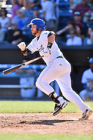 Asheville Tourists first baseman Brian Mundell (15) swings at a pitch during a game against the Rome Braves at McCormick Field on April 17, 2016 in Asheville, North Carolina. The Tourists defeated the Braves 12-5. (Tony Farlow/Four Seam Images)