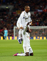 Pictured: Nathan Dyer of Swansea (on the ground) is celebrating his goal with team mate Wayne Routledge who is jumping over him. Sunday 24 February 2013<br />