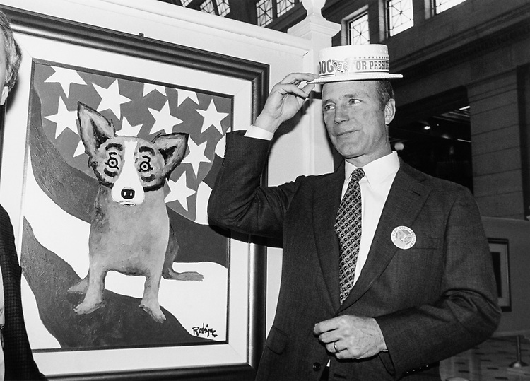 "Pete Geren, D-Tex. ""Bluedog"", puts on hat. ""B-dog for Prez"" at art exhibition at Union Station. May 13, 1996. (Photo by Laura Patterson/CQ Roll Call)"