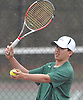 Nate Melnyk of Harborfields prepares to serve during a third doubles varsity boys tennis match against host Smithtown High School East on Tuesday, Apr. 29, 2016. The wheelchair-using junior played in his first varsity match, which was suspended in the first set due to rain. The match is set to resume on Monday, May 2.
