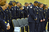 September 28, 2012  (Washington, DC)  Metropolitan Police Department graduating recruits during a moment of silence. This is the MPD's forth recruit class graduation at the police academy of 2012. Twenty-three regular officers and six reserve officers were sworn-in by Chief Cathy Lanier. (Photo by Don Baxter/Media Images International)