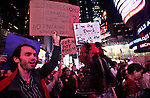 NewYork, United States, October 15, 2011..Protesters affiliated with the Occupy Wall Street movement, march around Times Square in New York October 15, 2011. VIEWpress /Kena Betancur..Protests inspired by the grassroots 'Occupy Wall Street' movement are planned for dozens of cities world-wide as part of a global day of action.Local media report.