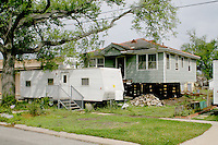 Hurricane Katrina damaged house reconstruction with relief trailer New Orleans Louisiana