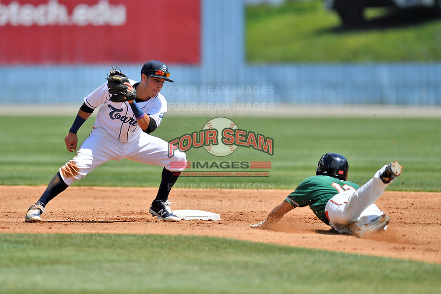 Asheville Tourists second baseman Jose Gomez (4) fields and attempts to put the tag on a hard sliding Corey Bird (18) during a game against the Greensboro Grasshoppers at McCormick Field on April 30, 2017 in Asheville, North Carolina. The Grasshoppers defeated the Tourists 7-0. (Tony Farlow/Four Seam Images)