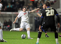 ATTENTION SPORTS PICTURE DESK<br /> Pictured: Craig Beattie shoots the ball off target<br /> Re: npower Championship, Swansea City FC v Portsmouth Football Club at the Liberty Stadium, south Wales. Friday 26 November 2010