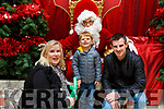 L-r, Aaron Framton Dillon with his parents Joanna and Jerome from Curraheen, Tralee visiting Santa Claus in the Manor West Shopping Centre on Saturday.