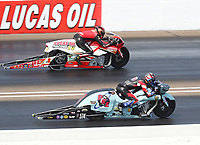 Sep 4, 2017; Clermont, IN, USA; NHRA pro stock motorcycle rider Eddie Reed (near) alongside Hector Arana Jr during the US Nationals at Lucas Oil Raceway. Mandatory Credit: Mark J. Rebilas-USA TODAY Sports