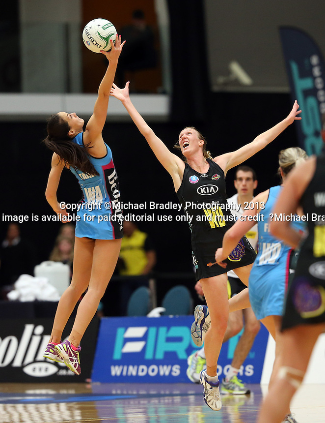 02.06.2013 Magic's Jodi Tod-Elliot and Steel's Courtney Tairi in action during the ANZ Champs netball match between the Magic and Steel played at Rotorua Events Centre in Rotorua. Mandatory Photo Credit ©Michael Bradley.