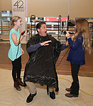 NEW YORK, NY - NOVEMBER 15:  Christopher Sieber during his 'Daddy Warbucks' hair transition with the help from cast members Cassidy Pry and Peyton Ella during the press presentation for The Holiday Return of the Broadway Hit Musical 'Annie' at the New 42nd Street Studios in New York City.  (Photo by Walter McBride/Getty Images)