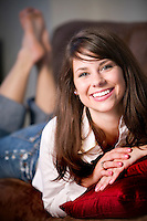 Eighteen year old female relaxing and looking at camera with a smile  Model Released