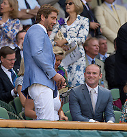 OIC - ENTSIMAGES.COM -  Gerard Butler and Wayne Rooney watch Andy Murray of Great Britain celebrates his win in the Gentlemen's Singles Final match against Novak Djokovic of Serbia of the Wimbledon Lawn Tennis Championships at the All England Lawn Tennis and Croquet Club 7th July 2013     Photo Ents Images/OIC 0203 174 1069