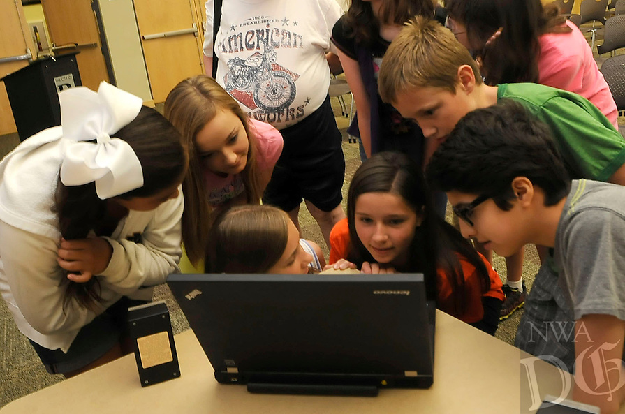 STAFF PHOTO FLIP PUTTHOFF <br /> Youths put ears close to Marshall's laptop on Tuesday June 17 2014 to hear sounds that could be paranormal activity. Mackenzie DeMania, front row from left, Maren Bayles aand Ervin Serrano, listen to the faint sounds.