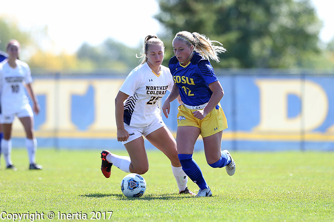 BROOKINGS, SD - SEPTEMBER 17:  Darien Poelstra #12 from South Dakota State University controls the ball in front of Taylor Bray #25 from Northern Colorado during their game Sunday afternoon at Fischback Soccer Field in Brookings. (Photo by Dave Eggen/Inertia)