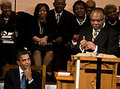 United States President Barack Obama (L) listens to an introduction by Pastor Cornelius Wheeler at Vermont Avenue Baptist Church, Sunday, January 17, 2010 in Washington, DC.  President Obama spoke during a service in honor of civil rights leader Dr. Martin Luther King Jr.  .Credit: Brendan Smialowski - Pool via CNP