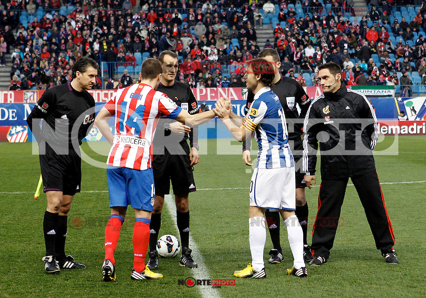 Referee Clos Gomez, Atletico de Madrid's Captain Gabi Fernandez and  and Espanyol's Captain Verdu during La Liga  match. February 24,2013.(ALTERPHOTOS/Alconada)