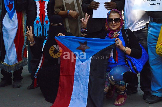 Members of Southern Yemeni community in Egypt hold their national flags as they protest outside the Arab league headquarters demanding that the formerly independent South secede as they celebrated the anniversary of the independence from British occupation Oct 14, 1963, in Cairo on October 14, 2014. Photo by Amr Sayed