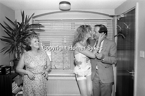 Office secretary his PA gives her boss a Kissogram girl as a birthday present London 1983