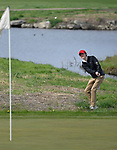 Kirkwood golfer Joe Avery chips onto the green at the 13th hole. Golfers in Suburban Central and Suburban XII Conference schools competed in a tournament at the Gateway National Golf Course in Madison, Illinois on Wednesday April 25, 2018.  Tim Vizer | Special to STLhighschoolsports.com