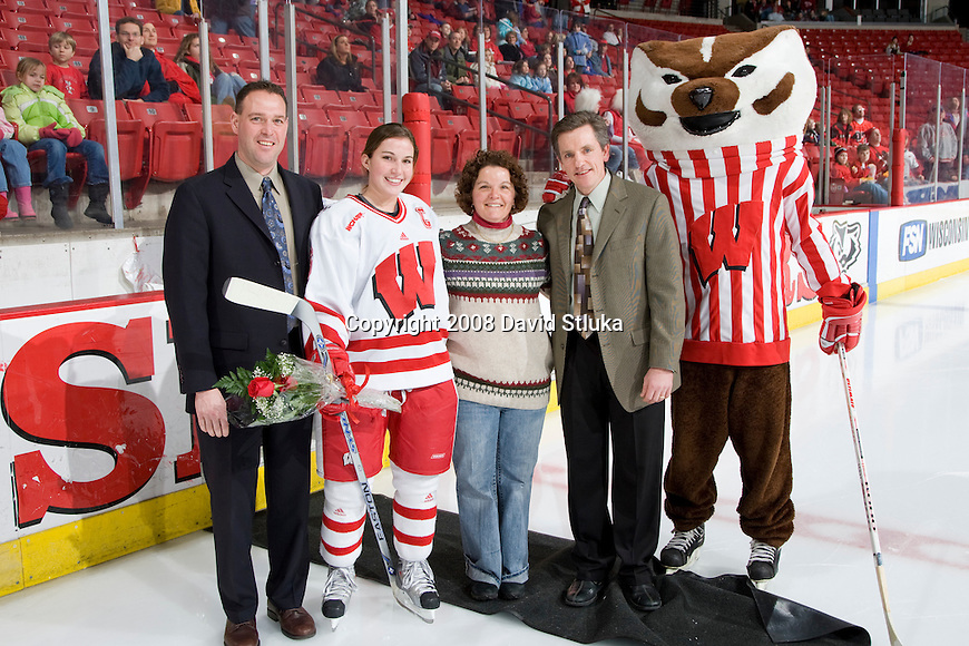 MADISON, WI - FEBRUARY 3: Senior Emily Morris #6 of the Wisconsin women's hockey team poses with her mother and coaches prior to the game against the North Dakota Fighting Sioux at the Kohl Center on February 3, 2008 in Madison, Wisconsin. Wisconsin beat North Dakota 5-2. (Photo by David Stluka)