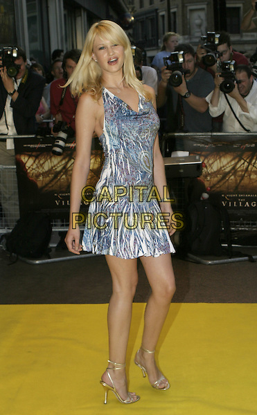 LANDI SWANEPOEL.UK Premiere of M. Night Shyamalan's The Village at Odeon West End Leicester Square, London W1.August 10th, 2004.full length, blue multi coloured summer dress, color.www.capitalpictures.com.sales@capitalpictures.com.© Capital Pictures.