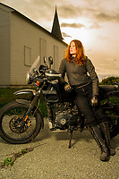 Aerial performer and local volunteer firefighter Erin Carey with her Royal Enfield motorcycle near the former Fort Ord U.S. Army base on March 6, 2020.