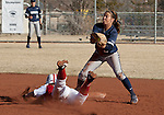 March 10, 2012:   Wisconsin Badgers Kendall Grimm is safe at second as Nevada Wolf Pack second baseman Caylin Campbell takes the throw during their NCAA softball game played as part of the The Wolf Pack Classic at Christina M. Hixson Softball Park on Saturday in Reno, Nevada.