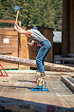 USA, Alaska, Ketchikan, one man competes to see how quickly he can chop down a stump during the Great Alaskan Lumberjack Show