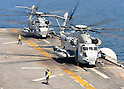 PACIFIC OCEAN (March 29, 2011) CH-53E Sea Stallion helicopters assigned to Marine Medium Helicopter Squadron (HMM) 262 prepare to take off from the forward-deployed amphibious assault ship USS Essex (LHD 2) to deliver humanitarian assistance supplies. Essex, with the embarked 31st Marine Expeditionary Unit (31st MEU), is operating off the coast of Kesennuma in northeastern Japan to support Operation Tomodachi. (Photo by U.S. Navy/AFLO) [0006]