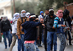 Palestinian protesters throw stones towards Israeli security forces during clashes next to the Jewish settlement of Psagot, near the West Bank city of Ramallah, November 3, 2015. The current wave of violence erupted in mid-September, fueled by rumors that Israel was trying to increase Jewish presence in Jerusalem then quickly spread across Israel, the West Bank and the Gaza Strip. Photo by Shadi Hatem