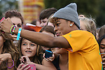 London, UK on Sunday 31st August, 2014. Mazzimaz takes a selfie with fans during the Soccer Six charity celebrity football tournament at Mile End Stadium, London.