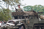 Reenactors showcase World War II tanks, half-tracks and support vehicles during the Museum of the America G.I.'s annual Open House on March 29, 2008 in College Station, Texas. An American half-track parades in front of the crowd.