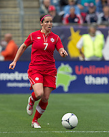 Canadian defender  Rhian Wilkinson (7) brings the ball forward. In an international friendly, Canada defeated Brasil, 2-1, at Gillette Stadium on March 24, 2012.