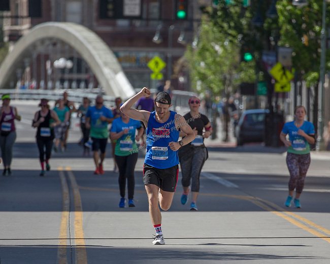 Rob Lugg, the men's marathon winner, celebrates as he heads toward the finish line in the Downtown River Run on Sunday, April 30, 2017 in Reno, Nevada.