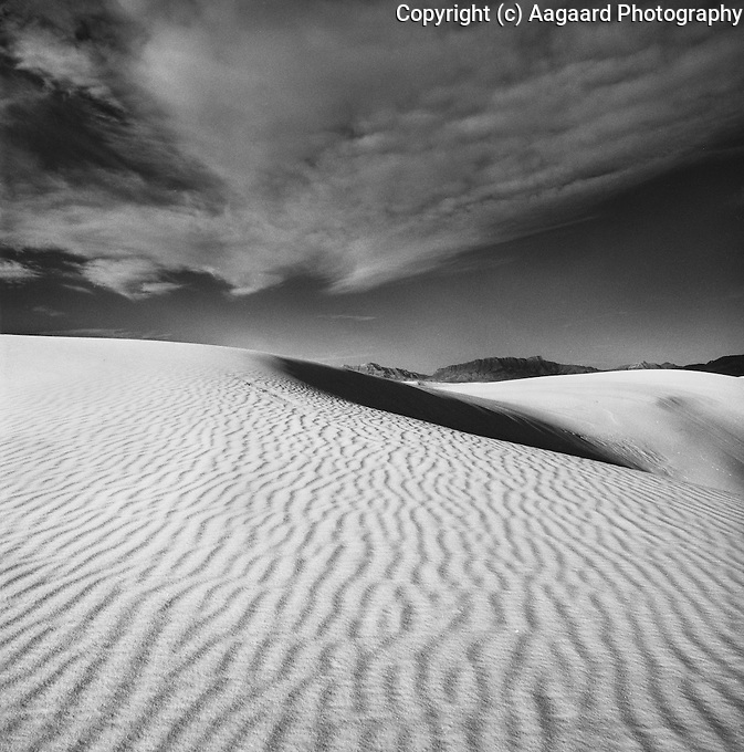 White Sands - dune and clouds.<br /> <br /> Hassleblad 500C/M, 50mm lens, Ilford XP2 film, red filter