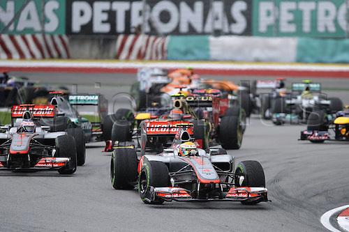 25.03.2012. Kuala Lumpur Malaysia.  The cars Start the grand prix of Malaysia as Lewis Hamilton GBR McLaren Mercedes and Jenson Button GBR McLaren Mercedes head into the first corner