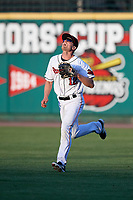 Rochester Red Wings right fielder Nick Buss (12) tracks a fly ball during a game against the Pawtucket Red Sox on May 19, 2018 at Frontier Field in Rochester, New York.  Rochester defeated Pawtucket 2-1.  (Mike Janes/Four Seam Images)