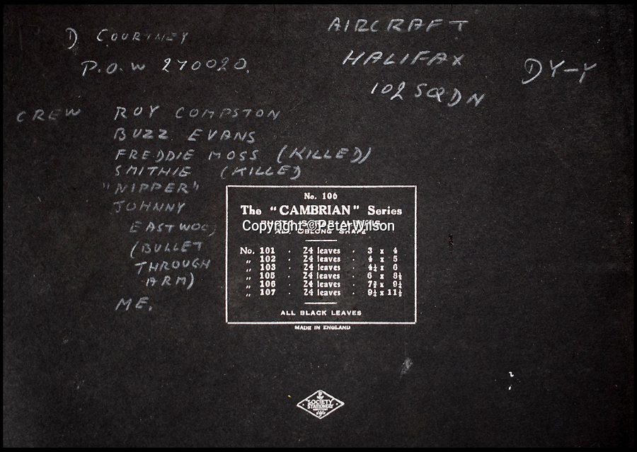 BNPS.co.uk (01202 558833)<br /> Pic: PeterWilson/BNPS<br /> <br /> The names of the crew on board the Halifax which was shot down, scribbled onto the cover of an album.<br /> <br /> A fascinating photo album has to come to light to reveal what went on inside a German POW camp - including stage shows in drag.<br /> <br /> The Stalag Luft IV B album was compiled by British prisoner David Courtney, of 102 Squadron, whose Halifax was shot down near Berlin on January 20, 1944.<br /> <br /> One of the photos shows the funeral of a British soldier who was assassinated by the German guards, although they have taken part in the ceremony by lifting their guns above the coffin.<br /> <br /> Another shows a theatre performance put on by inmates where the performers were dressed as women to keep up morale.