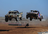Apr 16, 2011; Surprise, AZ USA; LOORRS driver Rick Huseman (36) leads Ricky Johnson (48) during round 3 at Speedworld Off Road Park. Mandatory Credit: Mark J. Rebilas-.